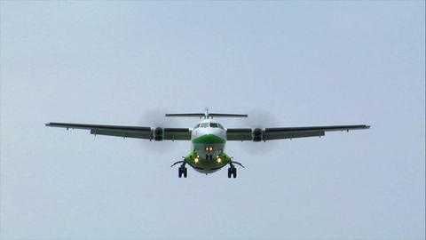 green white turbo prop plane fly over Stock Video Footage