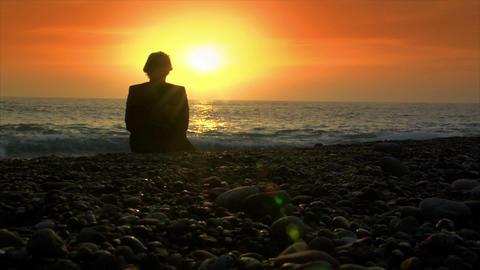 business man die on beach in sundown Stock Video Footage