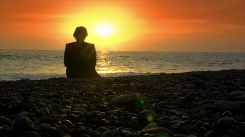 business man die on beach in sundown Footage