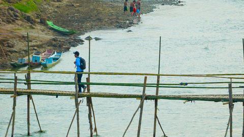 LUANG PRABANG. LAOS - CIRCA DEC 2013: Bamboo bridg Footage
