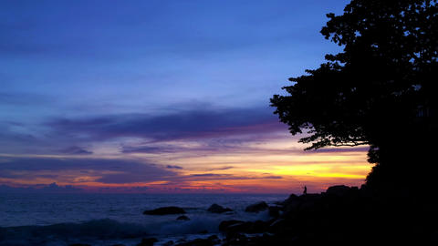 Rocky shore of tropical ocean at sunset. Timelapse Footage