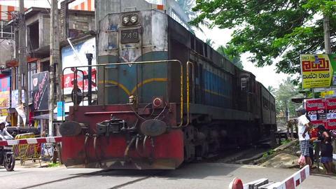 ALUTHGAMA. SRI LANKA - MAY 02: Passenger train pas Footage