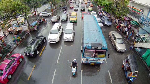 BANGKOK - APR 12: Cars and bus drive in a flow of Footage