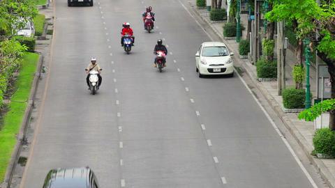 BANGKOK - APR 12: Cars. tuk tuk and taxis drive in Footage