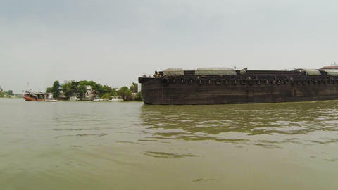 Large barges carrying goods on the river. Thailand Footage