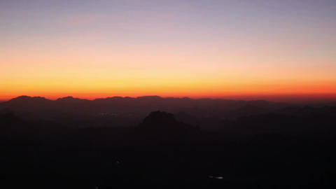 Distant City At Sunrise Dawn Under A Mountain stock footage