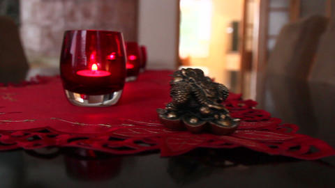 Three candles in red glass Footage