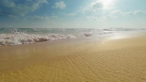 Sea surf on a sandy beach close-up Footage