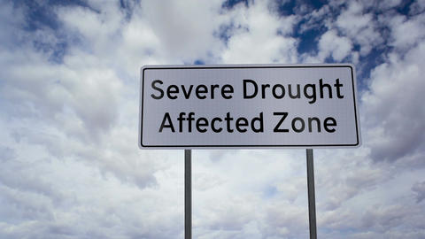 Sign Severe Drought Affected Zone Clouds Timelapse stock footage