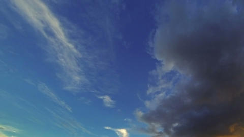 Clouds moving through the evening sky - timelapse Footage