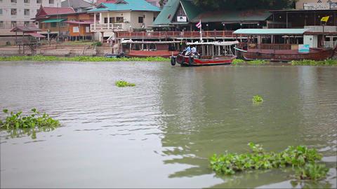 AYUTHAYA. THAILAND - APR 10: Ferry boat crosses a Footage