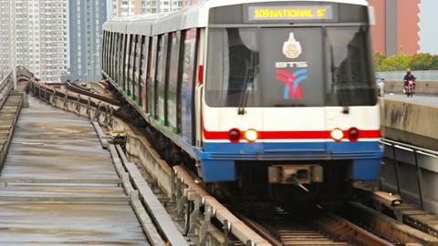 BANGKOK - APR 12: BTS sky train arrives on a stati Footage