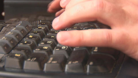 typing on the keyboard Stock Video Footage
