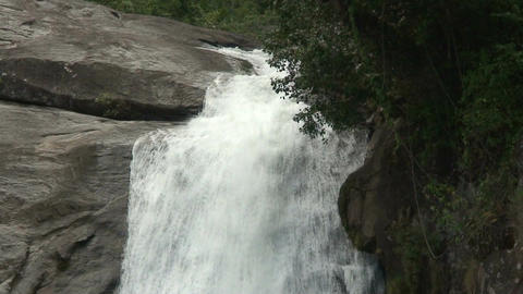 Malawi: waterfall in a rock hill at noon 2 Stock Video Footage