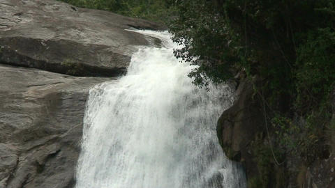 Malawi: waterfall in a rock hill at noon 2 Footage