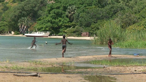 Malawi: african children playing in water Stock Video Footage