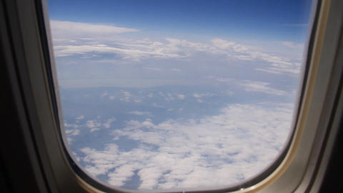 Aerial 02 through airplane window Stock Video Footage