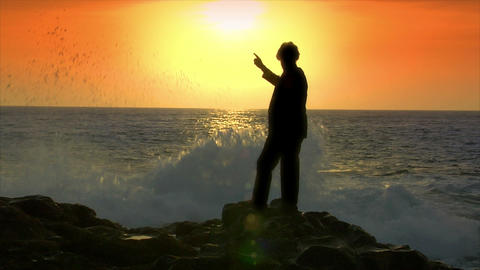 business man pointing finger sundown wave Stock Video Footage