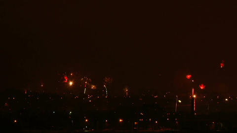 Time-lapse of New-Year switch fireworks over the city 3 Stock Video Footage