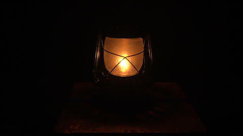 Oil lamp lit in the darkness. 4K Footage
