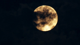 Orange Supermoon in a Cloudy Night Footage
