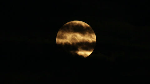 Scary Orange Super Moon With Clouds stock footage