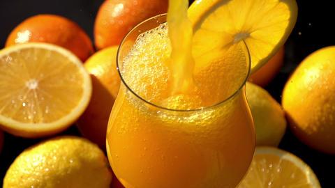 Poured Orange Juice Close Up Archivo
