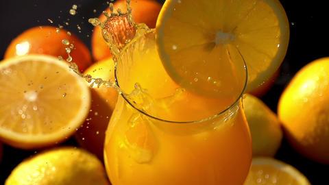 Drop Ice Cubes in Juice Closeup Footage