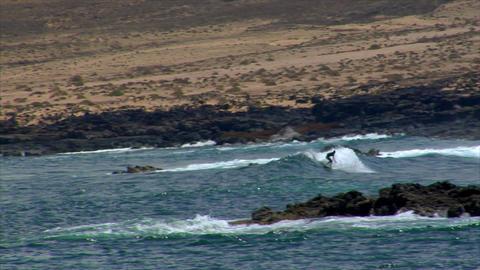 dangerous surfing between lava rocks Stock Video Footage