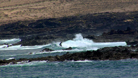 dangerous surfing between lava rocks Footage