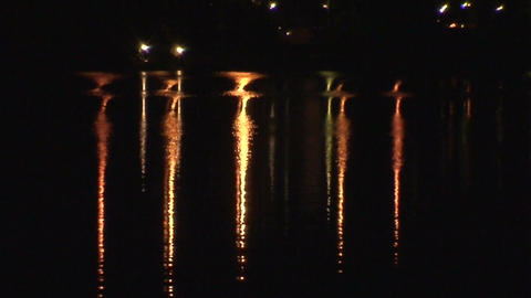 Reflections of electric lamps in a water 1 Stock Video Footage