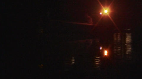 Security boat on a lake at night 2 Stock Video Footage