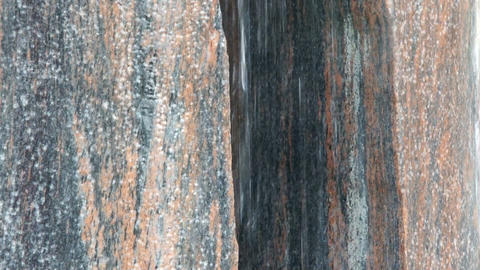 Water flowing on granite Stock Video Footage