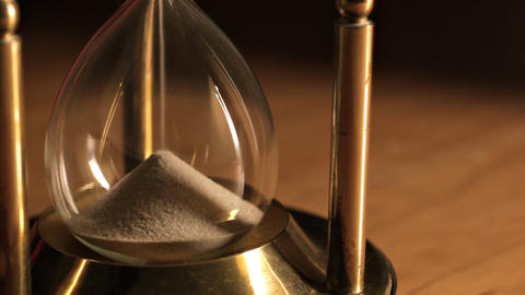 Sand running in hourglass Stock Video Footage