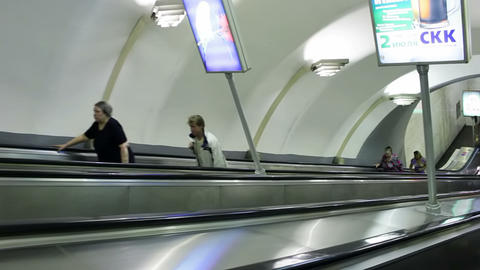 Escalator ride into subway station Chkalovskaya, S Stock Video Footage