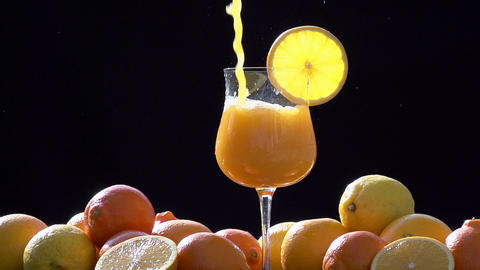 Orange Juice Flows In Glass stock footage
