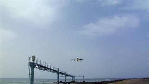 airplane landing over seaside audio Stock Video Footage