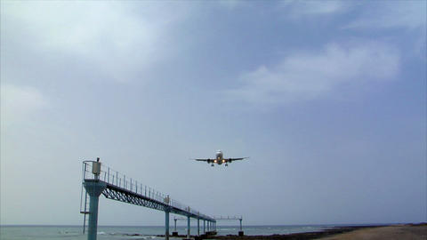airplane landing over seaside audio Footage