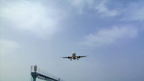 airplane landing over seaside audio Stock Video Footage