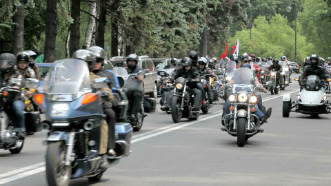 A large group of motorcyclists traveling on the road Stock Video Footage