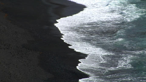 el golfo waves on black lava beach background Stock Video Footage