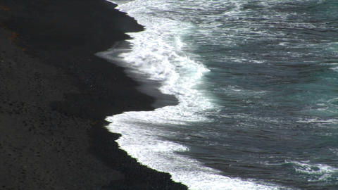 el golfo waves on black lava beach background Stock Video Footage