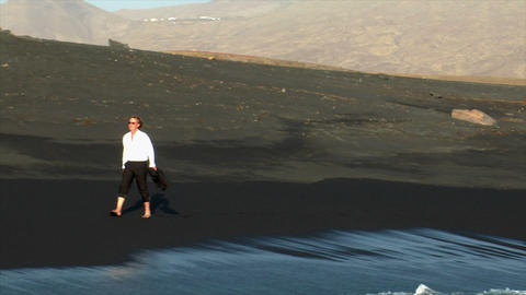 business man winking black lava beach Stock Video Footage