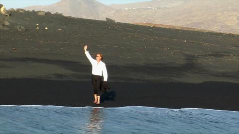 business man winking black lava beach Footage