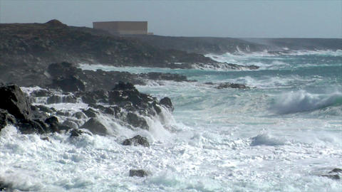 extreme wave crushing coast spray side Stock Video Footage