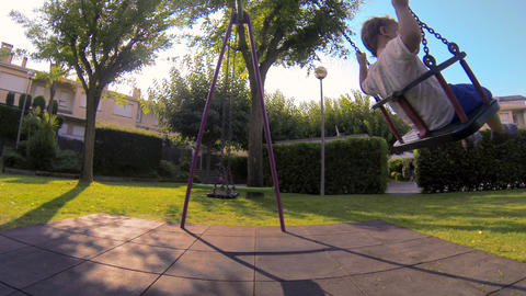 Baby Toddler in the Park Swing 01 Live Action
