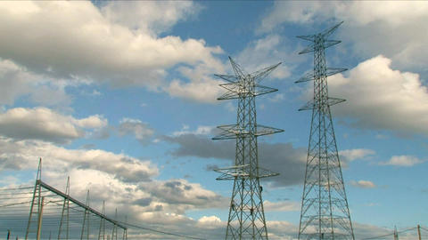 Electrical Towers With Workers Time Lapse stock footage