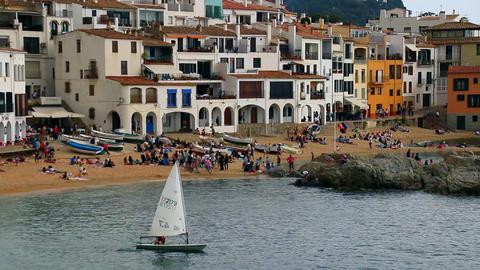 Optimist Dinghy Sailing In A Mediterranean Village stock footage