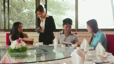 Young People Choosing Food From Menu In Restaurant stock footage