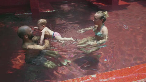 Father With Mother And Baby In Swimming Pool Footage